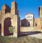 a view of San Pietro basilica in Tuscania with Friar John's arch