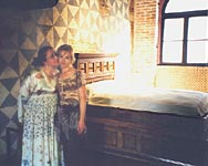 Juliet's House - museum in Verona. Cinzia and Olga among the props from Feffirell's film - the bed of Romeo and Juliet