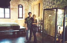 Vladimir and Olga near the bed and costumes from the film of Zeffirelli. Juliet's House museum in Verona