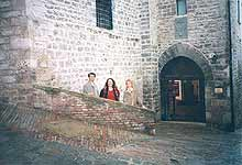 Gubbio. The brick parapet, on which Benvolio was seating with a book
