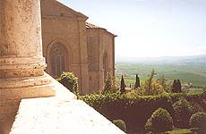 Pienza. The view of the Cathedral apse and Orcia valley from inside Palazzo Piccolomini