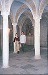 Olga and Vladimir inside the crypt of San Piero church - Capulet's family grave in the film